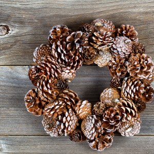 Christmas Pine Cone Wreath on Rustic Wood